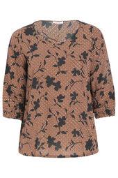 Een geometrische en fleurige blouse